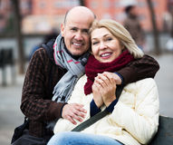 Mature couple on city walk Royalty Free Stock Photography