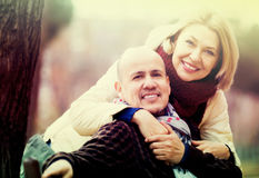 Mature couple on city walk stock photography