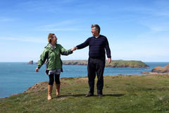Mature couple on the coastal path Stock Photos