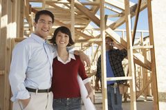 Mature Couple At Construction Site Stock Photo