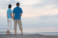 Mature couple contemplating the sunrise Stock Images