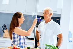 Mature couple cooking at home stock photo