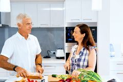 Mature couple cooking at home stock image