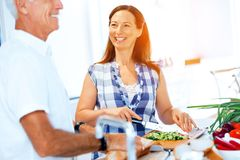 Mature couple cooking at home royalty free stock photo