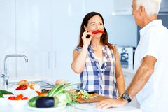 Mature couple cooking at home. Happy couple cooking together at home royalty free stock photography