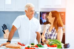 Mature couple cooking at home. Happy couple cooking together at home stock photo