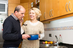 Mature couple cooking in kitchen Stock Photo