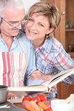 Mature couple cooking together Stock Image