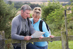 Mature Couple On Country Walk. Looking At Map royalty free stock images