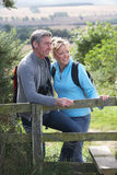 Mature Couple On Country Walk Royalty Free Stock Photos