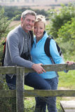 Mature Couple On Country Walk. Smiling To Camera stock photos