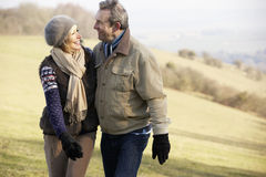 Mature couple on country walk in winter Royalty Free Stock Image