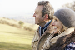 Mature couple on country walk in winter Royalty Free Stock Images