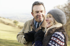 Mature couple on country walk in winter Royalty Free Stock Photos