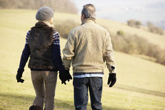 Mature couple on country walk in winter Royalty Free Stock Photo