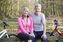 Mature Couple On Cycle Ride In Countryside Together Stock Photos