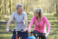 Mature Couple On Cycle Ride In Countryside Together. Mature Couple On Cycle Ride In Countryside Royalty Free Stock Images