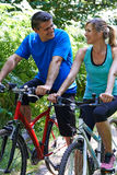 Mature Couple On Cycle Ride In Countryside Royalty Free Stock Image