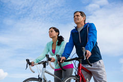 Mature couple cycling stock photography