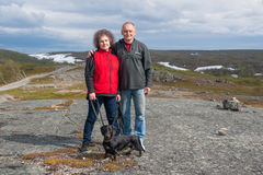 Mature couple with dachshund in mountains, Norway Stock Photography