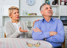 Mature couple decide family matters and find out relationship. Elderly ordinary mature couple decide family matters and find out relationship in his house Stock Photography
