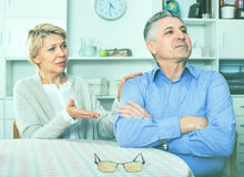Mature couple decide family matters and find out relationship. Elderly ordinary mature couple decide family matters and find out relationship in his house royalty free stock photos