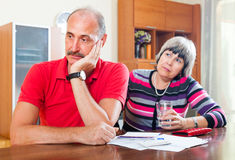 Mature couple did not have the money to repay the loan. Financial problems. Mature couple did not have the money to repay the loan Stock Images