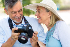 Mature couple with digital camera Royalty Free Stock Photos