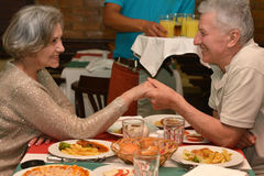 Mature couple at dinner. Happy mature couple eating dinner at restaurant Royalty Free Stock Photo