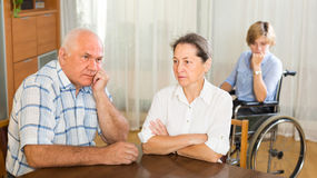Mature couple and disabled woman indoor Stock Images