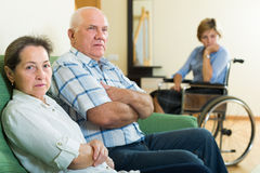 Mature couple and disabled woman indoor Stock Photo