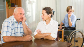 Mature couple and disabled woman indoor Royalty Free Stock Photo