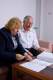 Mature couple. While discussing with papers on the table Royalty Free Stock Photo