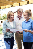 Mature Couple Discussing Plan With Landscape Gardener Royalty Free Stock Photo
