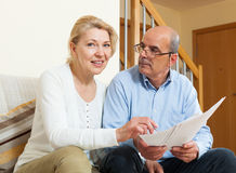 Mature couple with documents at home Stock Photography