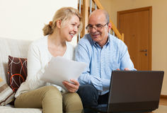 Mature couple with documents and notebook royalty free stock photos