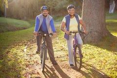 Mature couple doing a bike ride stock image