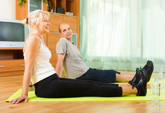 Mature couple doing exercises Royalty Free Stock Photography