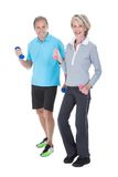 Mature Couple Doing Exercising With Dumbbells Royalty Free Stock Photos