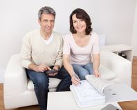 Mature couple doing family finances. At home Royalty Free Stock Images