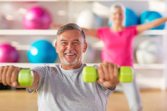 Mature couple doing fitness exercises Stock Photos