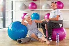 Mature couple doing fitness exercises Royalty Free Stock Images