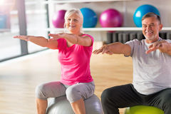 Mature couple doing fitness exercises Royalty Free Stock Image