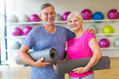 Mature couple doing fitness exercises Stock Photography
