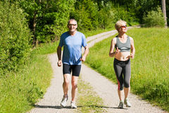 Mature couple doing sport - jogging Stock Photo