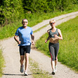 Mature couple doing sport - jogging Stock Photos