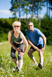 Mature couple doing sport outdoors stock images