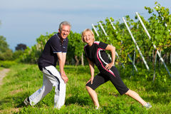 Mature couple doing sport outdoors Royalty Free Stock Photography