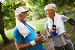 Mature couple is doing sport outdoors. Healthy lifestyle concept stock photos
