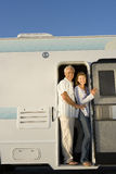 Mature couple in door of motor home, smiling, portrait Royalty Free Stock Photography